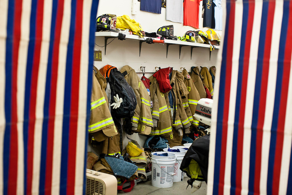 Fire fighting equipment is visible between voting booths in the Canaan Fire Station on Tuesday, January 10, 2012 in Canaan, NH. Brendan Hoffman for the New York Times
