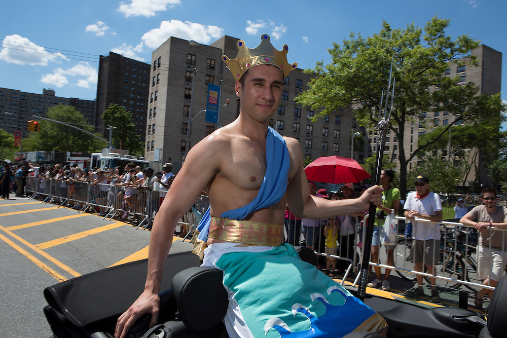 Neptune and his trident ride down the parade route.