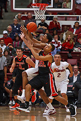 Feb 16, 2012; Stanford CA, USA; Stanford Cardinal guard/forward Anthony Brown (back) steals the ball from Oregon State Beavers guard Roberto Nelson (55) during the first half at Maples Pavilion.  Mandatory Credit: Jason O. Watson-US PRESSWIRE