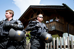 05.06.2015, Garmisch Partenkirchen, GER, G7 Gipfeltreffen auf Schloss Elmau, Circa 300 Menschen demonstrieren in Garmisch-Patenkirchen gegen den G7-Gipfel im benachbarten Elmau, im Bild Polizisten vor Bauernhaus in Garmisch-Patenkirchen // during Protest of the G7 opponents prior to the scheduled G7 summit which will be held from 7th to 8th June 2015 in Schloss Elmau near Garmisch Partenkirchen. Garmisch Partenkirchen, Germany on 2015/06/05. EXPA Pictures © 2015, PhotoCredit: EXPA/ Eibner-Pressefoto/ Gehrling<br /> <br /> *****ATTENTION - OUT of GER*****