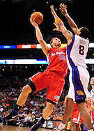 Apr. 1, 2011; Phoenix, AZ, USA; Los Angeles Clippers forward Blake Griffin (32) puts up a shot against the Phoenix Suns forward Channing Frye (8) at the US Airways Center. The Suns defeated the Clippers 111-98. Mandatory Credit: Jennifer Stewart-US PRESSWIRE