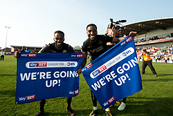 Free to use courtesy of Sky Bet - Cheyenne Dunkley and Gavin Massey of Wigan Athletic celebrate winning promotion to the Sky Bet Championship- Mandatory by-line: Robbie Stephenson/JMP - 21/04/2018 - FOOTBALL - Highbury Stadium - Fleetwood, England - Fleetwood Town v Wigan Athletic - Sky Bet League One