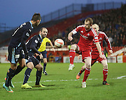Aberdeen's Mark Reynolds clears from Dundee's Luka Tankulic and Gary Harkins -  Aberdeen v Dundee, SPFL Premiership at Pittodrie <br />
