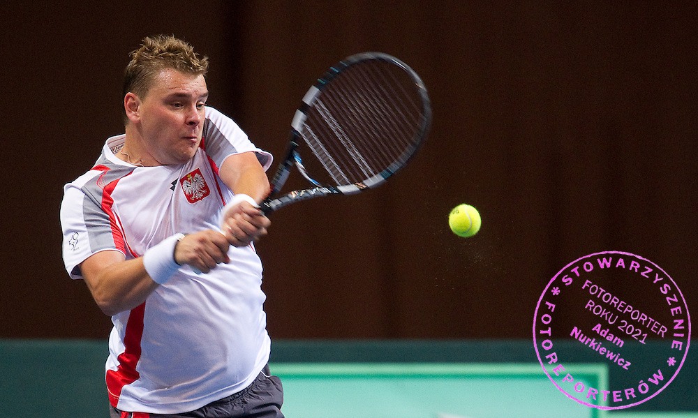 Marcin Matkowski of Poland competes at man's singles match at third day during the BNP Paribas Davis Cup 2012 between Poland and Belarus at MOSiR Hall in Lodz on September 16, 2012...Poland, Lodz, September 16, 2012..Picture also available in RAW (NEF) or TIFF format on special request...For editorial use only. Any commercial or promotional use requires permission...Photo by © Adam Nurkiewicz / Mediasport