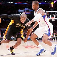 31 October 2014: Los Angeles Lakers guard Kobe Bryant (24) drives past Los Angeles Clippers guard Chris Paul (3) during the Los Angeles Clippers 118-111 victory over the Los Angeles Lakers, at the Staples Center, Los Angeles, California, USA.