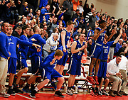 Beford High School basketball players and fans react during the MIAA Division 3 North Sectional Final game against Watertown High School at Burlington High School, March 11, 2017. The Raiders won, 59-52.    [Wicked Local Photo/James Jesson]