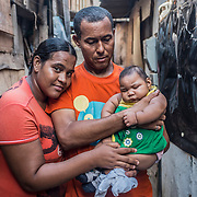 Paulo (49), Maria (20) and their daughter with microcephaly Eduarda Vitoria (5 months) in front of their house, a shelter where they live in the slum of Santa Luzia in Recife, Pernambuco. Both of them are unemployed and extremely poor