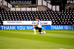 Chris Martin of Derby County takes the knee before kick off in front of 'Thank You NHS' messages - Mandatory by-line: Ryan Crockett/JMP - 11/07/2020 - FOOTBALL - Pride Park Stadium - Derby, England - Derby County v Brentford - Sky Bet Championship