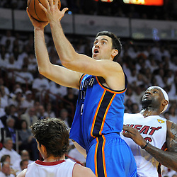 Jun 17, 2012; Miam, FL, USA; Oklahoma City Thunder power forward Nick Collison (4) drives against Miami Heat small forward LeBron James (6) during the first quarter in game three in the 2012 NBA Finals at the American Airlines Arena. Mandatory Credit: Derick E. Hingle-US PRESSWIRE