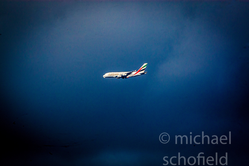 """An Airbus A380 """"super jumbo"""" operated by Emirates, on it's way to Glasgow Airport, the first Scottish airport to welcome the world's largest commercial aircraft."""