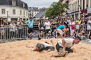 People take part in the sport of gouren, a type of wrestling that has been found in Bretagne for hundreds of years, on Sunday, July 24, 2016 in Quimper, France.