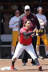 26 April 2015:   Catching the put out throw to first for the Redbirds is Jordan de los Reyes during an NCAA Missouri Valley Conference (MVC) Championship series women's softball game between the Loyola Ramblers and the Illinois State Redbirds on Marian Kneer Field in Normal IL