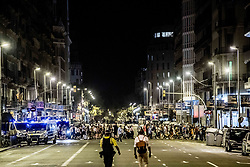 Police officers stand guard in a cordoned off area after a van ploughed into the crowd, killing 13 persons and injuring several others on the Rambla in Barcelona, Spain, on August 17, 2017. At least 13 people have been killed and dozens were injured after a white van ploughed into a crowd in Barcelona's busy tourist area, according to local media. Photo by Robin Utrecht/ABACAPRESS.COM