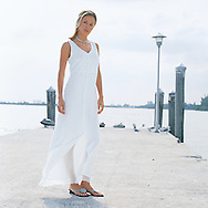 We photographed Luba for an upscale fashion catalog on a deserted pier, wearing a white knot dress.