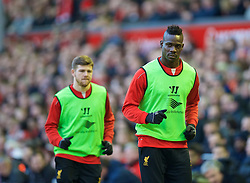 LIVERPOOL, ENGLAND - Sunday, March 8, 2015: Liverpool's substitutes Mario Balotelli and Alberto Moreno warm-up during the FA Cup 6th Round Quarter-Final match against Blackburn Rovers at Anfield. (Pic by David Rawcliffe/Propaganda)