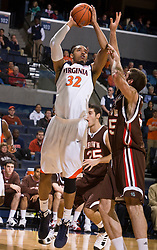 Virginia forward Mike Scott (32) shoots a jump shot over Brown forward Peter Sullivan (25).  The Virginia Cavaliers defeated the Brown University Bears 74-50 in NCAA Basketball at the John Paul Jones Arena on the Grounds of the University of Virginia in Charlottesville, VA on January 6, 2009.