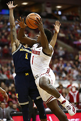 December 4, 2017 - Columbus, OH, USA - Ohio State Buckeyes forward Jae'Sean Tate (1) shoots over Michigan Wolverines guard Charles Matthews (1) during the first half on Monday, Dec. 4, 2017, at Value Center Arena in Columbus, Ohio. (Credit Image: © Fred Squillante/TNS via ZUMA Wire)