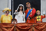 Friends mimick the William and Kate wedding balcony image as the great British public brave bad weather to celebrate the Queen's Diamond Jubilee flotilla on the river Thames. 1,000 boats made their way past Battersea Park, London including their reigning monarch of 60 years and other members of the royal family during a weekend of official festivities and street parties.