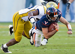 Virginia quarterback Marc Verica (6) dives for extra yardage on a rush past Georgia Tech running back Jamal Paige (25).  The Virginia Cavaliers defeated the #18 ranked Georgia Tech Yellow Jackets 24-17 in NCAA Division 1 Football at Bobby Dodd Stadium on the campus of Georgia Tech in Atlanta, GA on October 25, 2008.
