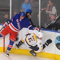 New York Rangers left wing Brandon Dubinsky (17) checks Nashville Predators defenseman Shea Weber (6) to the ice during second period NHL action between the New York Rangers and the Nashville Predators at Madison Square Garden in New York, NY.