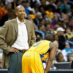 January 22, 2011; New Orleans, LA, USA; New Orleans Hornets head coach Monty Williams talks with point guard Chris Paul (3) during the third quarter of a game against the San Antonio Spurs at the New Orleans Arena. The Hornets defeated the Spurs 96-72.  Mandatory Credit: Derick E. Hingle