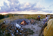 Pine Ridge Sioux Indian Reservation, South Dakota, Oglala Sioux (Lakota) Grassy Creek Tiospaye, Russell Redner, AIM Leader, and friend prepare sweat lodge.