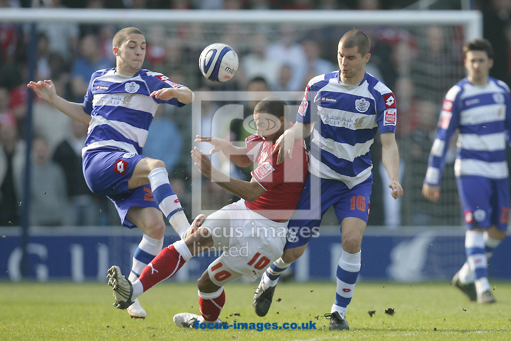 London - Saturday March 21st, 2009: Matthew Connolly (R) and Hogan Ephraim (L) of QPR in action against Nicky Maynard (C) of Bristol City during the Coca Cola Championship match at Loftus Road, London. (Pic by Mark Chapman/Focus Images)
