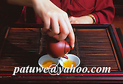 A lady pouring the first tea on the tea pot,  Chinese tea ceremony, Hong Kong, china