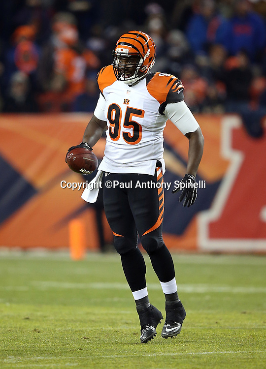 Cincinnati Bengals defensive end Wallace Gilberry (95) leaps and celebrates after a third down stop forces a first quarter punt by the Denver Broncos during the 2015 NFL week 16 regular season football game against the Denver Broncos on Monday, Dec. 28, 2015 in Denver. The Broncos won the game in overtime 20-17. (©Paul Anthony Spinelli)