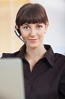 Businesswoman wearing telephone headset portrait