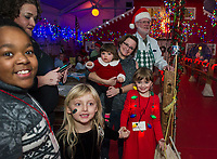 The Dionne and Harper family began coming to Christmas Village as children 30 years ago and now bring their children to experience the magic of Christmas on opening night.  (Karen Bobotas/for the Laconia Daily Sun)