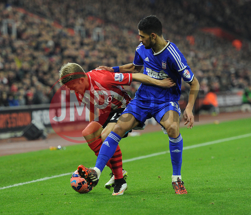 Southampton's Lloyd Isgrove and Ipswich Town's Kevin Bru tussle for the ball - Photo mandatory by-line: Paul Knight/JMP - Mobile: 07966 386802 - 04/01/2015 - SPORT - Football - Southampton - St Mary's Stadium - Southampton v Ipswich Town - FA Cup Third Round