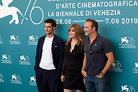 Venice, Italy, 30th August 2019, Louis Garrel, Emmanuelle Seigner and  Jean Dujardinat the photocall for the film J'Accuse (An Officer And A Spy) at the 76th Venice Film Festival, Sala Grande. Credit: Doreen Kennedy/Alamy Live News
