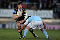 Exeter Chiefs Ian Whitten is tackled by Newcastle Falcons Rob Vickers - Photo mandatory by-line: Harry Trump/JMP - Mobile: 07966 386802 - 14/02/15 - SPORT - Rugby - Aviva Premiership - Sandy Park, Exeter, England - Exeter Chiefs v Newcastle Falcons