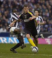 Photo: Matt Bright/Richard Lane Photography.<br /> West Bromwich Albion v Cardiff City. Coca Cola Championship. 19/01/2008. <br /> Paul Parry of Cardiff is held off the ball by Leon Barnett of West Bromwich Albion