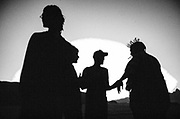Silhouettes of four people at Middle East Tek, Wadi Rum, Jordan, 2008