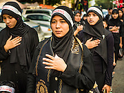 23 OCTOBER 2015 - YANGON, MYANMAR: Women beat their chests and pray during an Ashura procession in Yangon. Ashura commemorates the death of Hussein ibn Ali, the grandson of the Prophet Muhammed, in the 7th century. Hussein ibn Ali is considered by Shia Muslims to be the third imam and the rightful successor of Muhammed. He was killed at the Battle of Karbala in 610 CE on the 10th day of Muharram, the first month of the Islamic calendar. According to Myanmar government statistics, only about 4% of the population is Muslim. Many Muslims have fled Myanmar in recent years because of violence directed against Burmese Muslims by Buddhist nationalists.    PHOTO BY JACK KURTZ