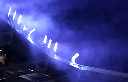 The smoke from flares lit from the Reading fans is lit up by the Madejski stadium floodlights - Photo mandatory by-line: Robbie Stephenson/JMP - Mobile: 07966 386802 - 16/03/2015 - SPORT - Football - Reading - Madejski Stadium - Reading v Bradford City - FA Cup - Quarter Final - Replay