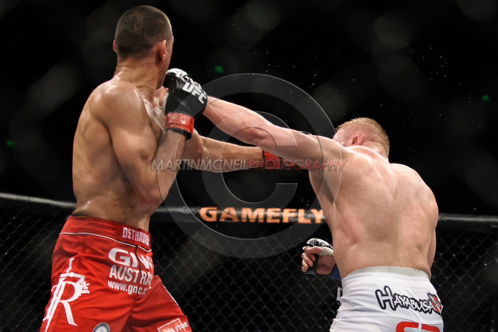 """SYDNEY, AUSTRALIA, FEBRUARY 27, 2011: George Sotiropoulos (left) is stunned by a right jab from Dennis Siver during """"UFC 127: Penn vs. Fitch"""" inside Acer Arena in Sydney, Australia on February 27, 2011."""