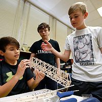 Thomas Wells   BUY at PHOTOS.DJOURNAL.COM<br /> Guntown Middle School students Mason Sancillo, 13, from left, Spencer Olson, 13, and Noah Johnson,, 13, see what sections of their bridge failed during their past competetion before begin rebuilding the bridge and making improvments for the upcoming national competetion.