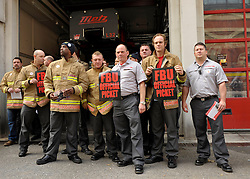 © Licensed to London News Pictures.  25/09/2013. Bristol, UK. Fire fighters walk out at Station No. 9 at Temple in Bristol.  The Fire and Rescue services in England and Wales staged a 4 hour strike over changes to pension entitlement if fire fighters are unfit to continue working past the age of 55.  The Government wants fire fighters to work till they are 60 to achieve a full pension but the Fire Brigades Union says very few if any fire fighters are fit enough at 60 to work on the front line fighting fires.  14 January 2013.<br /> Photo credit : Simon Chapman/LNP