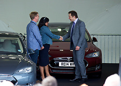 LONDON, ENGLAND - Saturday, June 7, 2014: CEO & Chief Product Architect Elon Musk hands over the keys to the third customer of the Model S, 50 Shades of Grey author EL James (Erika Mitchell), at the UK launch of Tesla Motors' Model S electric car at the Crystal. (Pic by David Rawcliffe/Propaganda)