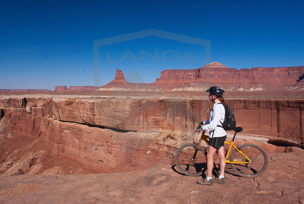 mountain biking on the white rim trail in canyonlands national park, utah.