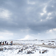 In subfreezing snowy weather, refugees walk the unoffical refugee crossing from the Tabanovce, Macedonia Train Station across the Serbian border. Near Miratovac, Serbia, January 2016.