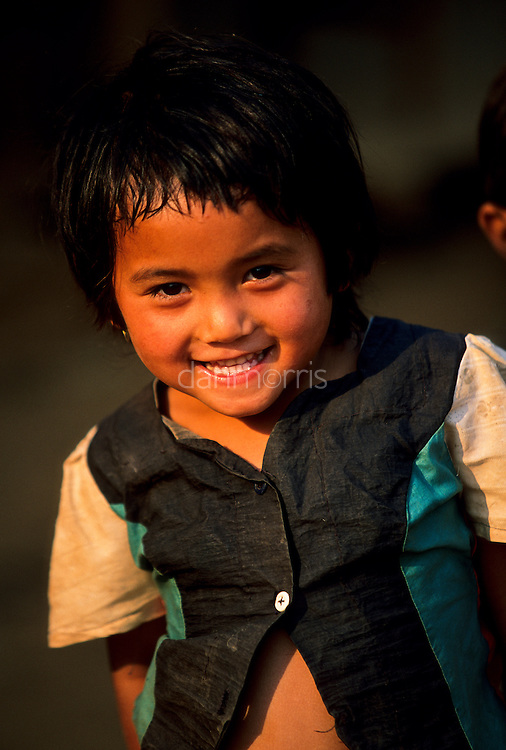 Akha Hill Tribe Girl smiles for the camera, Muang Singh, Laos