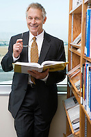 Businessman smiling in library, portrait