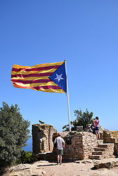 Catalonia, Spain Sep 2017. Catalonian flag on top of Castell de Begur