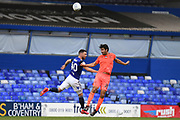 Huddersfield Town defender Christopher Schindler (26) heads the ball under pressure from Birmingham City forward (on loan from Aston Villa) Scott Hogan (40) during the EFL Sky Bet Championship match between Birmingham City and Huddersfield Town at the Trillion Trophy Stadium, Birmingham, England on 1 July 2020.