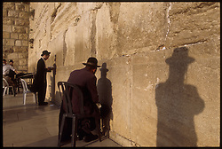 Orthodox Jews pray at the Western Wall, despite the ongoing violence, which has kept many of the faithful away. Control over East Jerusalem, where many of the holiest sites of the Jewish, Muslim and Christian faiths are located, continues to be a major point of contention in the ongoing peace negotiations. (Photo © Jock Fistick)