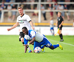 Bristol Rovers' Snaquille Hunter goes down under the challenge from Hereford United's Josh O'Keefe - Photo mandatory by-line: Dougie Allward/JMP - Tel: Mobile: 07966 386802 16/07/2013 - SPORT - FOOTBALL - Bristol -  Hereford United V Bristol Rovers - Pre Season Friendly